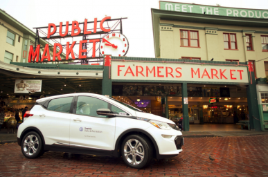 Electric car in front of Pike Place Market