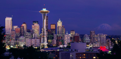 Seattle skyline at night, image for building electrification forum
